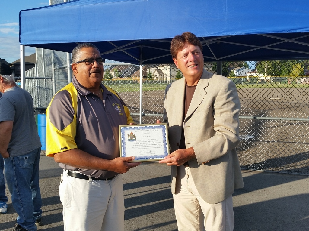 Terry Whitehead presenting Guido Kelly with a certificate of appreciation for all of his hard work on the William McCulloch Park on behalf of the West Mountain Baseball Association